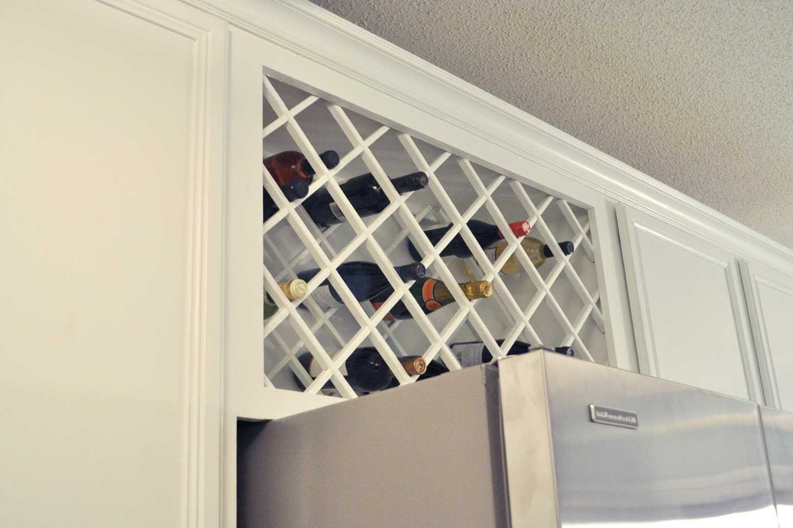 Build wine rack insert home design ideas for Building a wine rack in a cabinet