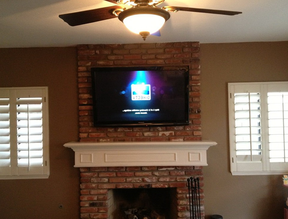 installing fireplace hiding above tv image on description enter into brick wires mounting
