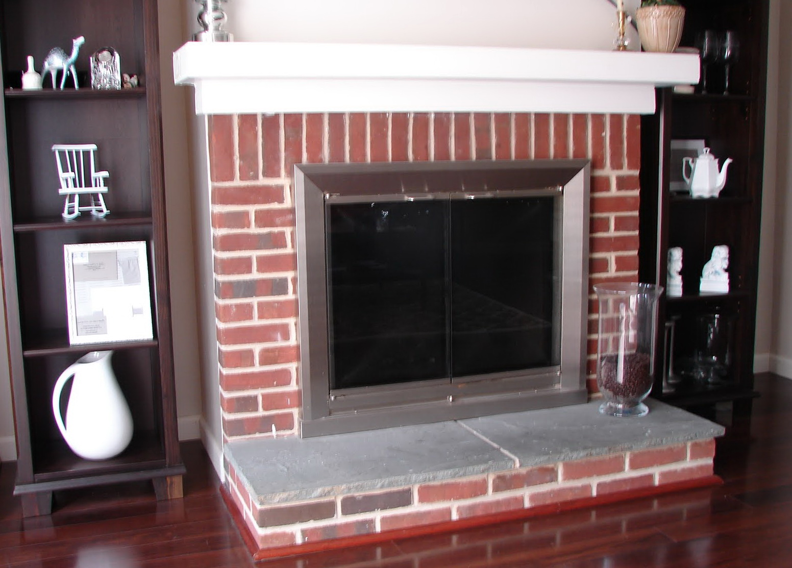 traditional styling in this living room includes red brick