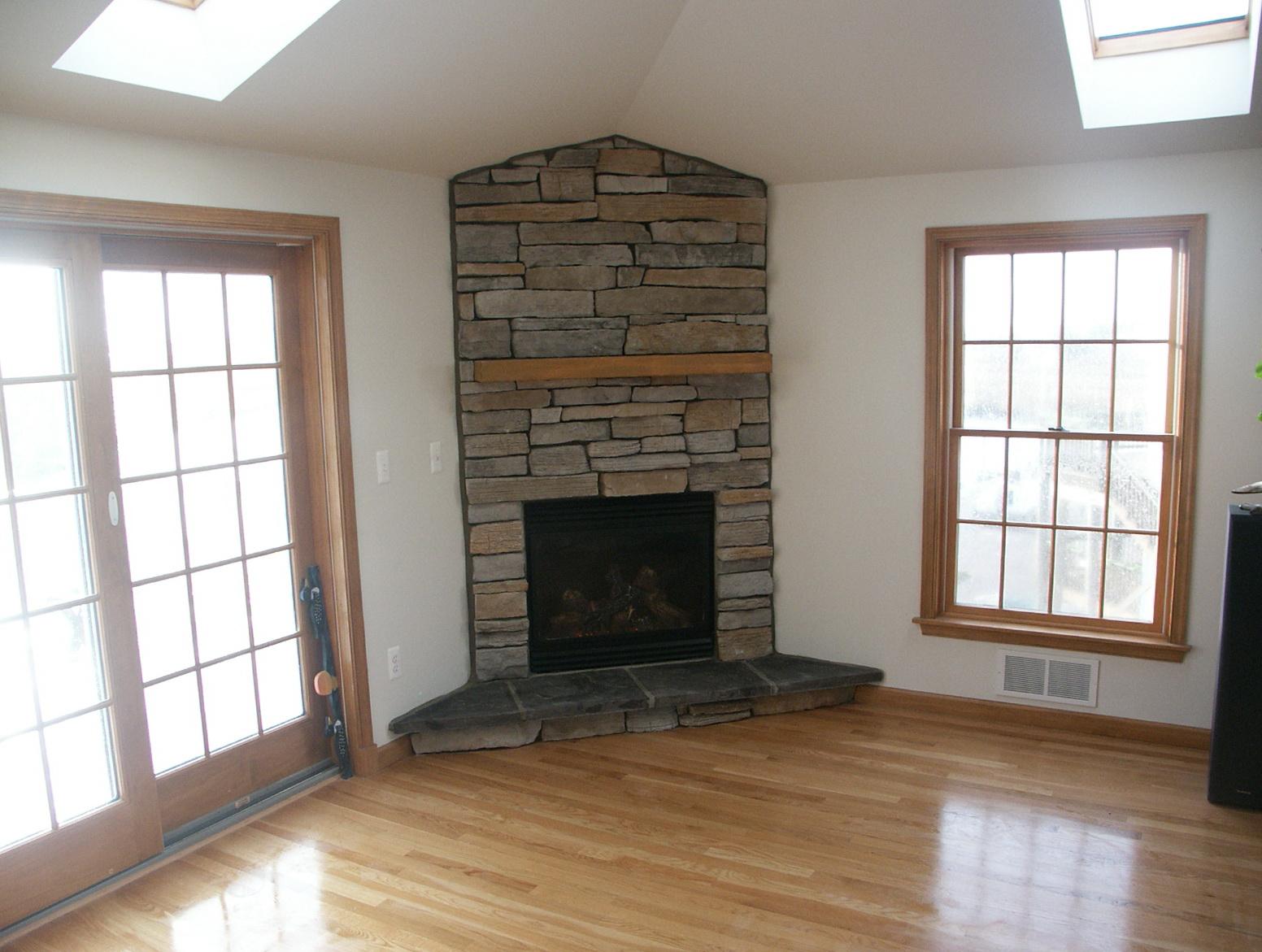 Corner stone gas fireplace home design ideas for Corner stone fireplace
