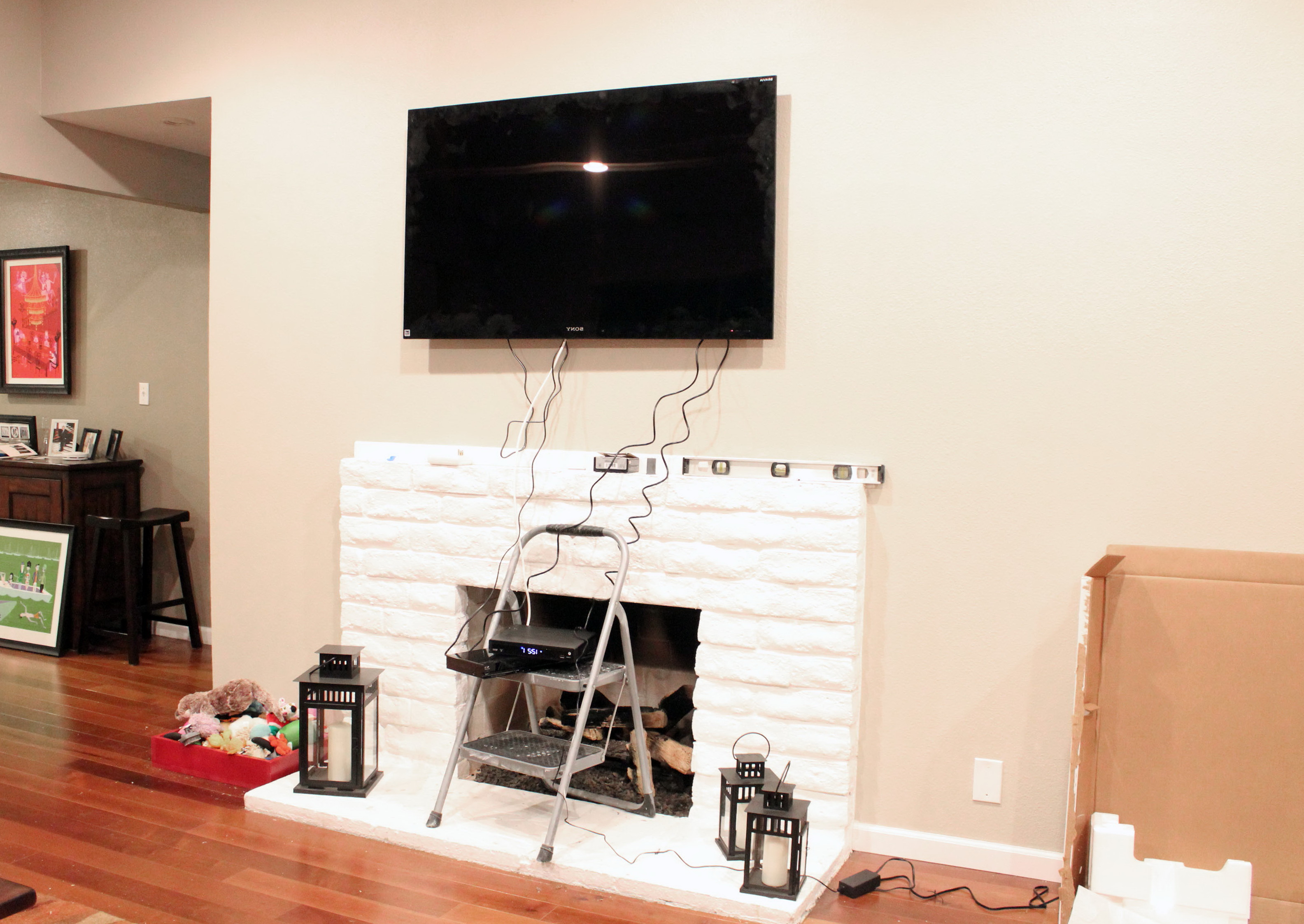 Tv Mounted Above Fireplace Where To Put Cable Box Home