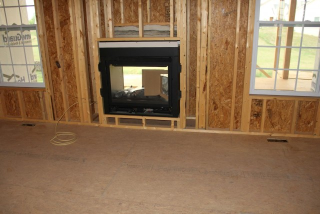 Double sided gas fireplace inside outside home design ideas for Inside outside fireplace