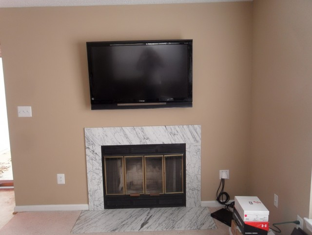 Tv Mounted Over Fireplace Where To Put Cable Box Great We Mounted