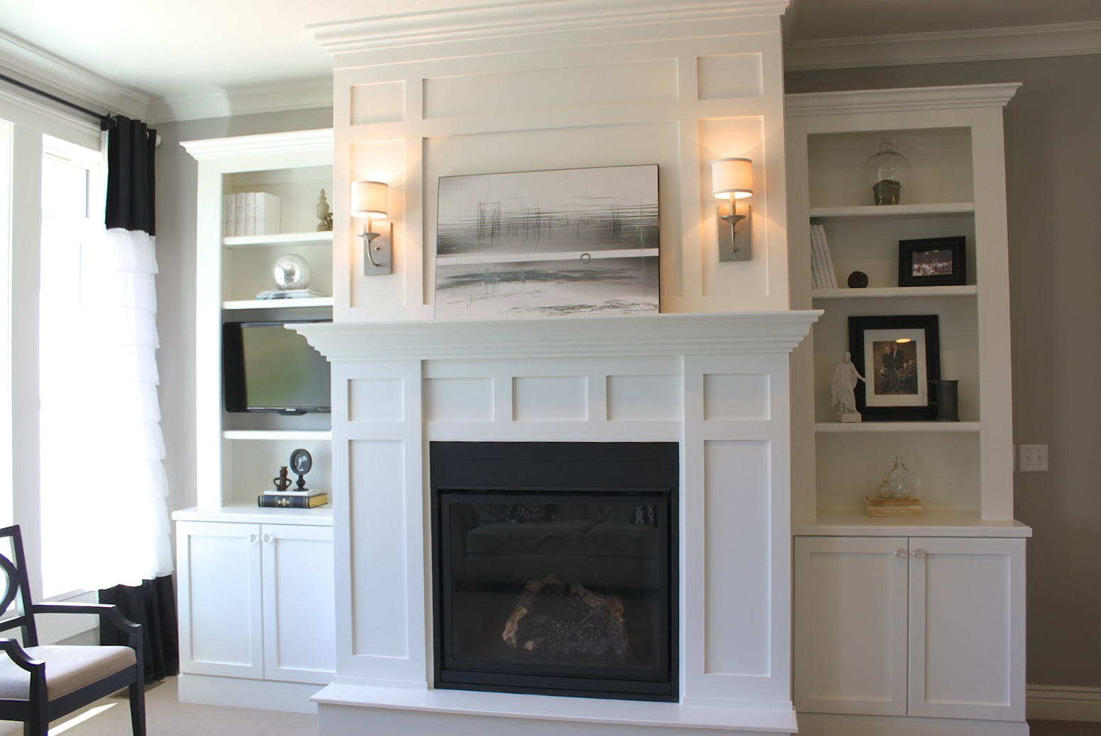 Elegant White Built In Cabinets Around Fireplace