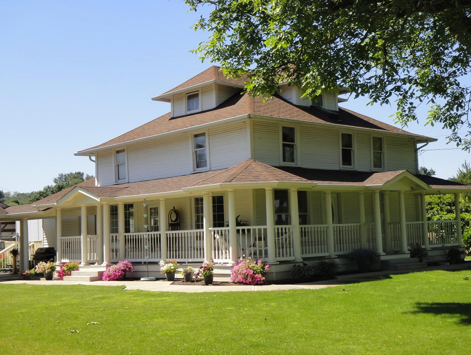 Country Farmhouse With Wrap Around Porch