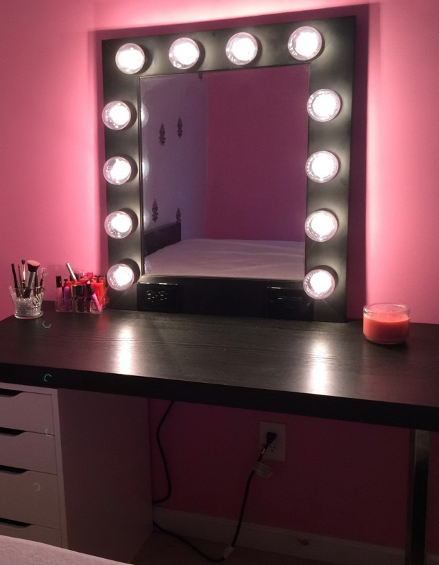 Vanity With Lights Around Mirror