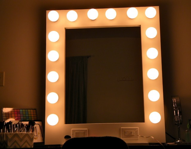 Vanity With Lights On Mirror