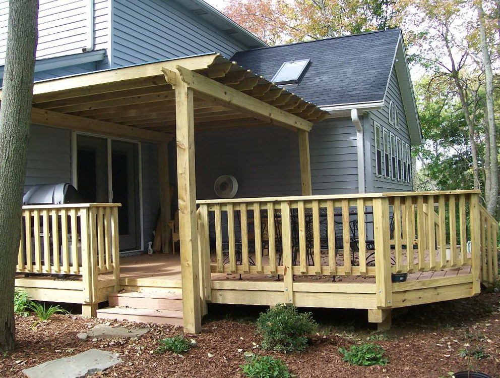 Wood porch railing designs home design ideas for Wooden front porch designs